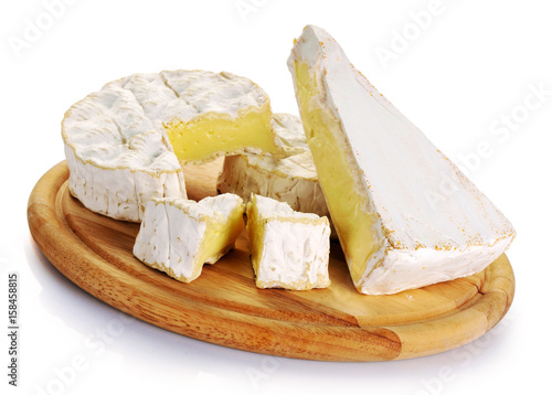 Camembert cheese and brie on wooden board