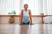 Beautiful Woman Practices Yoga Asana At Home