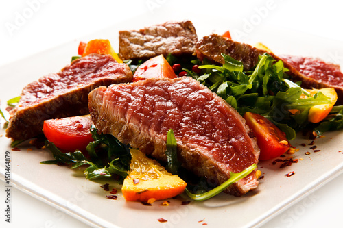 Fillet mignon - grilled beefsteaks with vegetables on white background Wallpaper Mural