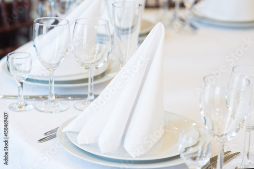 Fotobehang Restaurant Restaurant interior for banquet, wedding. Glass, napkins and cutlery. Table appointments, laying
