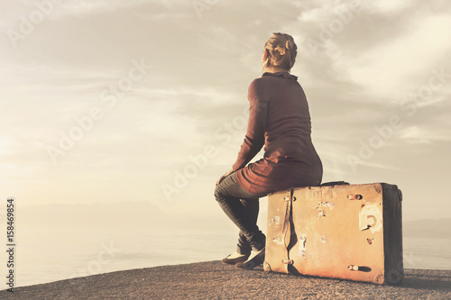 Travel woman arrived at destination enjoying the wonderful view Fototapeta