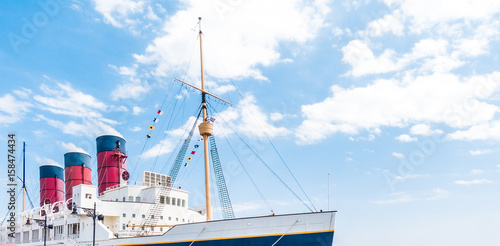 Photo Stands Ship Giant passenger Steam Boat with blue sky copy space