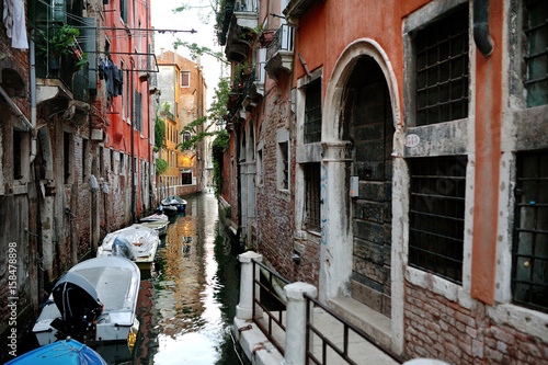 Wall Murals Scooter Venice, Italy - scenic view of venetian canal