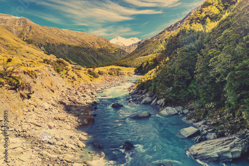 Valokuva  Wild New Zealand river in Mount Aspiring National Park, New Zealand, with vintag