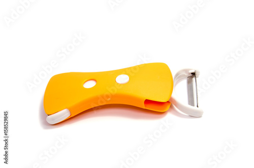 Stainless steel knife slicer tool  to shred fruit vegetable cheese, isolated on Wallpaper Mural