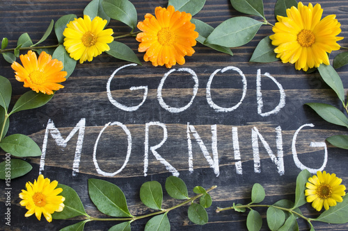 Words Good Morning With Leaves And Marigold Flowers Buy This Stock