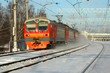 A passenger train goes by rail in winter