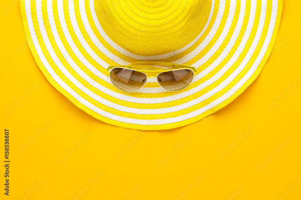 Fototapeta yellow sunglasses and striped retro hat. summer concept