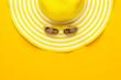 Leinwanddruck Bild - yellow sunglasses and striped retro hat. summer concept