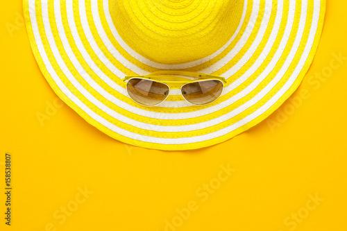 yellow sunglasses and striped retro hat. summer concept