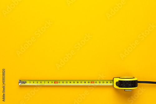 Obraz tape measure on the yellow background with copy space - fototapety do salonu