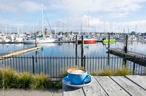 Canvas Prints New Zealand Cup of flat white coffee at Marsden Cove Marina, Whangarei, New Zealand, NZ