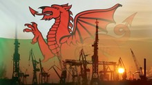 Industrial Concept With Wales Flag At Sunset