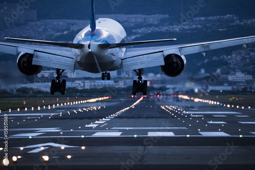 In the evening, the plane is about to land on the runway Canvas Print