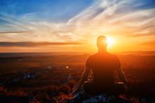 Rear View Of The Man Meditatin...