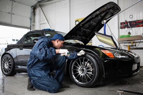 Fotografie, Obraz  Sports car in a workshop