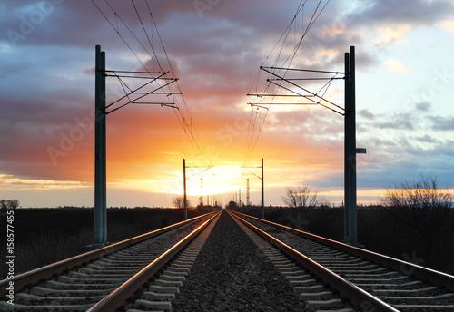 Poster Voies ferrées Dramatic sunset over railroad