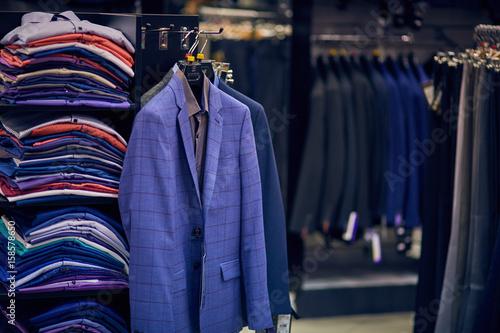Fotografija  Men's jackets on hangers in the men's store