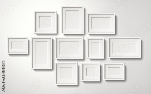 fototapeta na ścianę Blank white picture frames