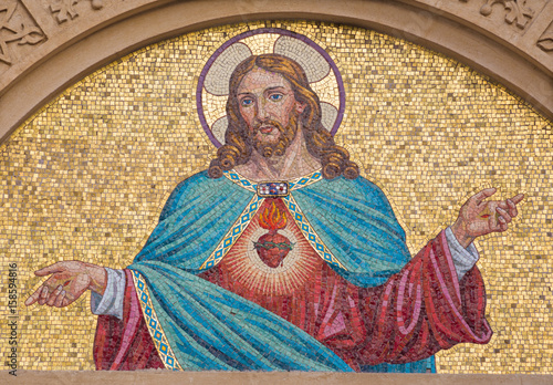 Fotografie, Obraz TURIN, ITALY - MARCH 15, 2017: The mosaic of Heart of Jesus on the facade of  Chiesa del Sacro Cuore di Gesu on the square Piazza Maria Ausiliatrice by unknown artist from end of 19