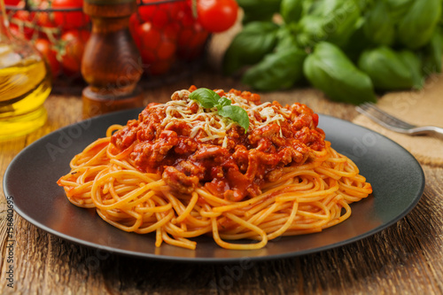Delicious spaghetti served on a black plate Fototapeta