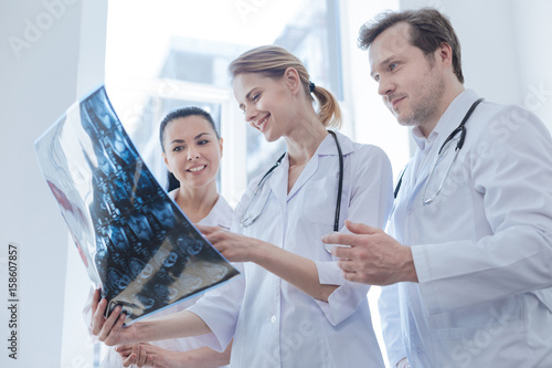 Obraz Glad oncologists discussing ct scan result in the clinic - fototapety do salonu