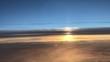 Coucher de soleil dans le ciel en avion