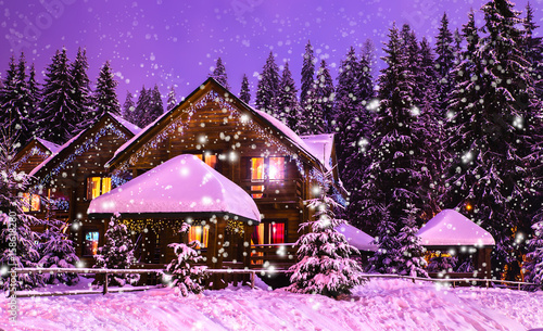 Fotografering  A fairy-tale house in the woods amid the snow-covered fir trees, Christmas landscape