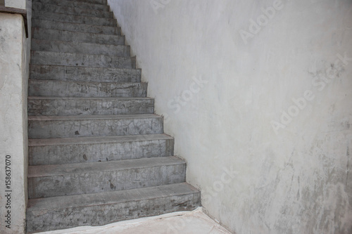 Spoed Foto op Canvas Trappen Old stair way inside old building with clear concrete wall