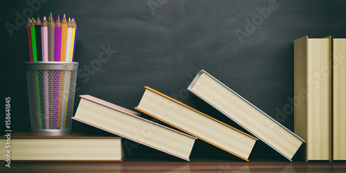 Fotografie, Obraz  Colored pencils and books on a blackboard background