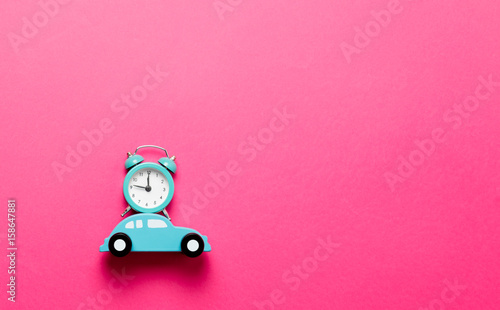 Valokuva  Blue little car with retro alarm clock