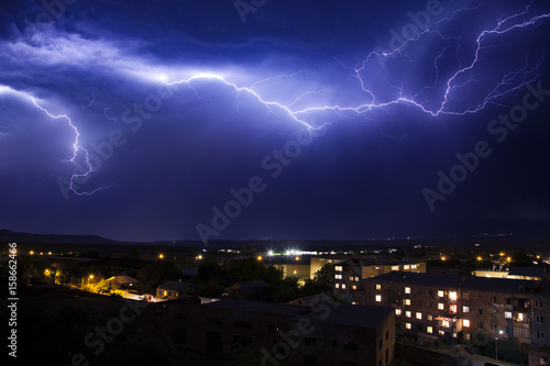 lightning in the sky in the city weather anomaly disaster Canvas Print
