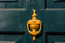 Door With Brass Knocker In The Shape Of A Decor, Beautiful Entrance To The House