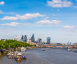 Panoramic city of london, ships on the river thames, modern and old buildings