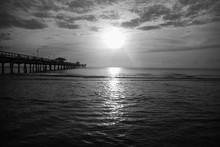Sun Over Ocean With Cloudy Sky...