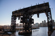 iconic gantries of Gantry State Park on the East river and buildings in Manhattan