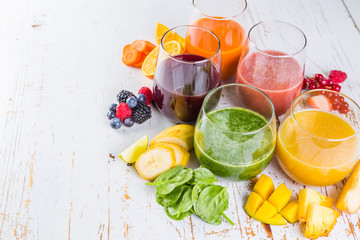 NaklejkaSelection of colourful smoothies on rustic wood background