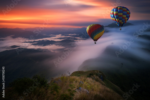 Hot air balloon over Pha Tang hill with beautiful mountain view and fog in morni Canvas Print