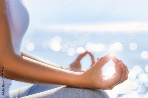 Obraz na płótnie Conceptual yoga hands in morning sunlight.