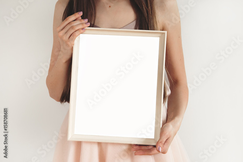 Girl\'s hands holding frame. mockup - Buy this stock photo and ...