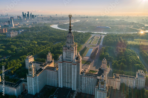 Poster Moscow Moscow state university and Moscow city business center at sunrise. City in fog. Russia. Aerial View.