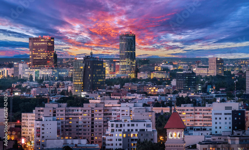 Aerial view of the business district in Bucharest, Romania at sunset Wallpaper Mural