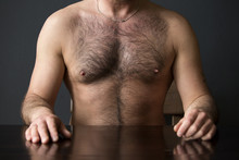 Hairy Chest Of Man Sitting At ...