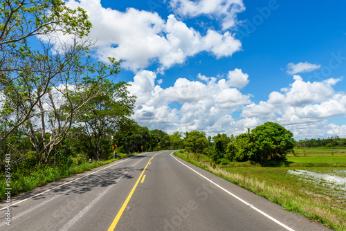 Fotobehang Landschap Winding Paved Road with blue sky in the mountain.