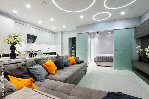 Valokuva  Modern white living studio with bedroom doors open