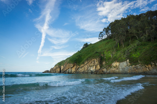 Beautiful beach in the north of Spain, nature of Asturias in warm summer day плакат