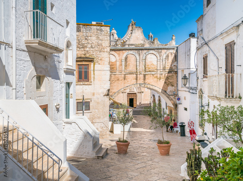 Canvas Prints Narrow alley Scenic view in Ostuni, city located about 8 km from the coast, in the province of Brindisi, region of Apulia, Italy.