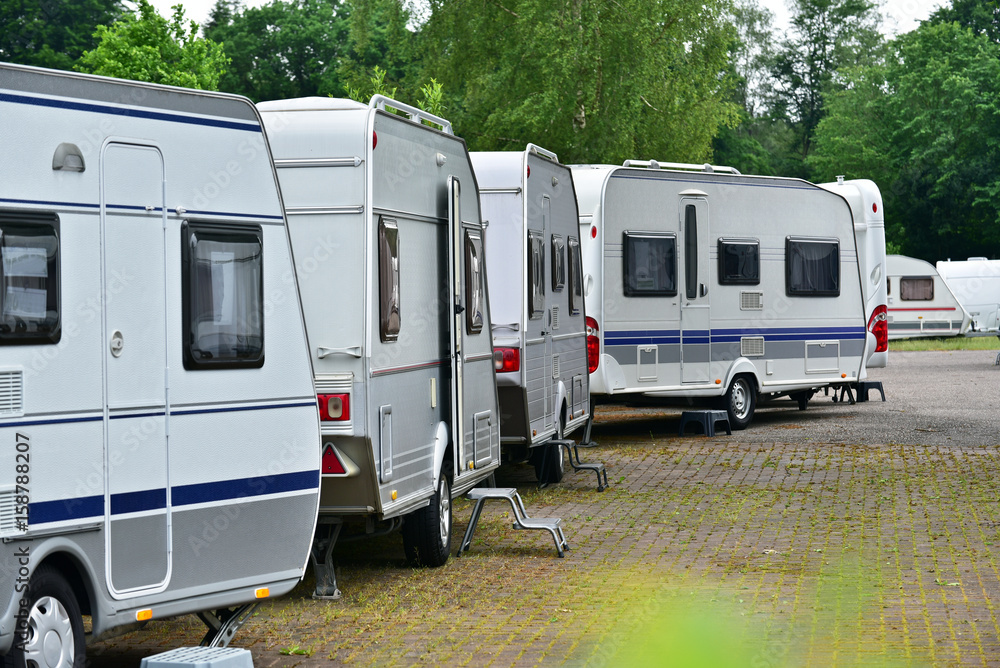 Fototapety, obrazy: New touring caravans parked in a row on a travel trailer trade park