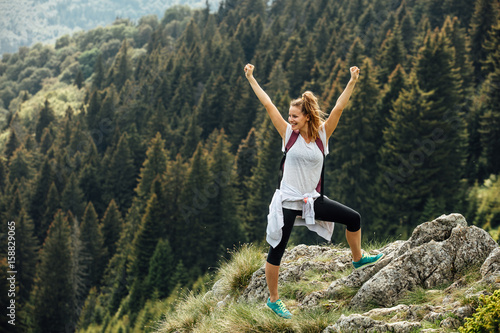 single woman on top of the mountains