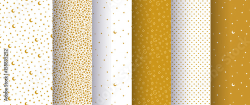 Photo Set of seamless simple abstract patterns with gold or yellow stars and moons on white background